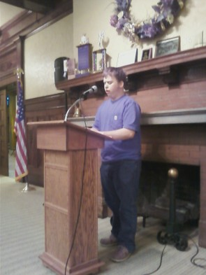 High School Student Noah Johnson reads at magazine release 2014