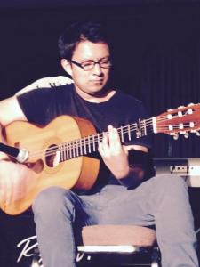 Daniel Hernandez plays guitar at Open Mic